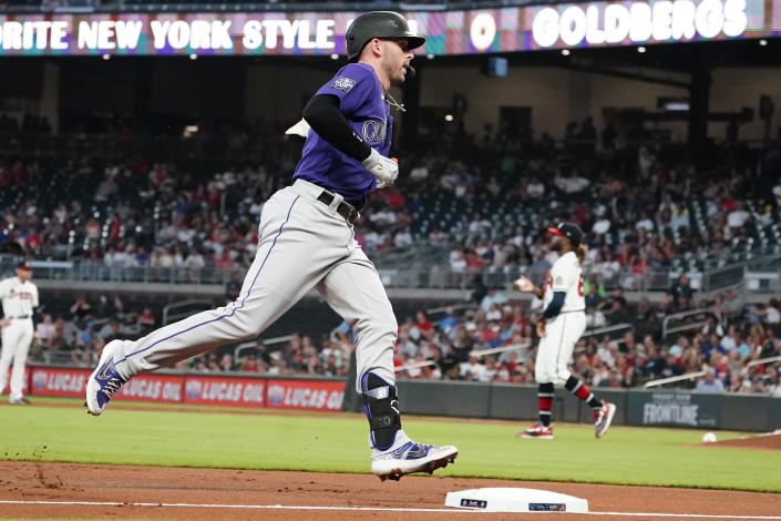 Colorado Rockies shortstop Trevor Story (27) rounds the bases after hitting a solo home run in the first inning of a baseball game against the Atlanta Braves Tuesday, Sept. 14, 2021, in Atlanta. (AP Photo/John Bazemore)