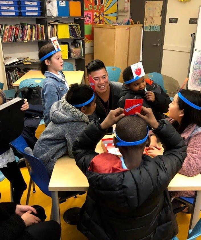 Hans Miguel Esguerra, 29, is shown here during a volunteer tutoring session at the Boys and Girls Club of San Francisco. Esquerra emigrated at age 7 from the Philippines along with his large family and is still hoping to become a United States citizen and continue with his career at a global professional services firm.