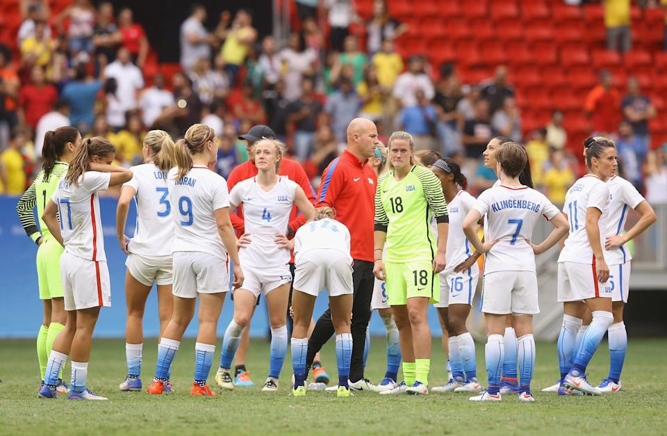 USWNT players react to their loss to Sweden in penalty kicks at the 2016 Olympics.