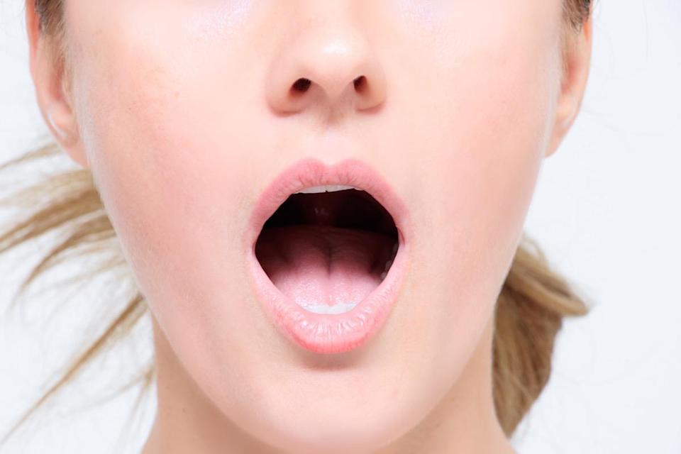 woman breathing with her mouth open