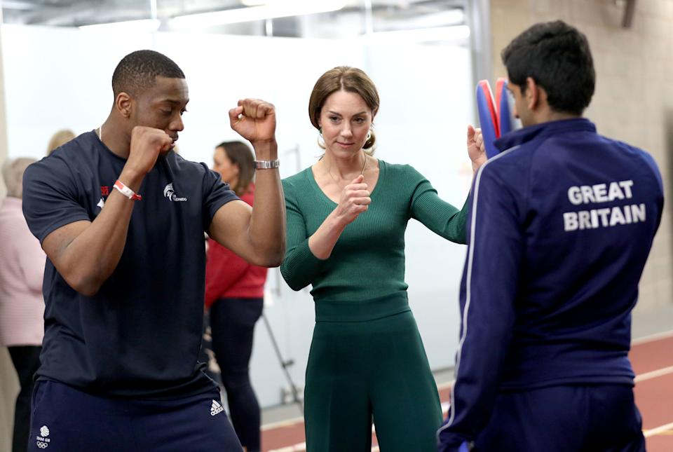 LONDON, ENGLAND - FEBRUARY 26: Catherine, Duchess of Cambridge is shown Taekwondo moves by Great Britain's Lutalo Muhammad (L) during a SportsAid Stars event at the London Stadium in Stratford on February 26, 2020 in London, England. (Photo by Yui Mok - WPA Pool/Getty Images)