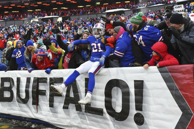 "Bills safety <a class=""link rapid-noclick-resp"" href=""/nfl/players/26841/"" data-ylk=""slk:Jordan Poyer"">Jordan Poyer</a> celebrates with fans in Buffalo's victory against Miami last month. (AP)"