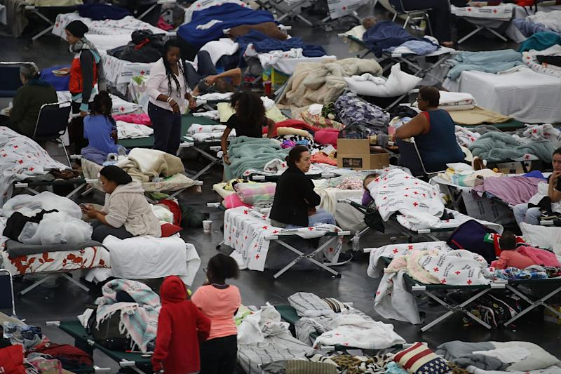 People are seen sheltering at the George R. Brown Convention Center in Houston after floodwaters from Hurricane Harvey inundated the city in 2017. (Photo: Joe Raedle via Getty Images)