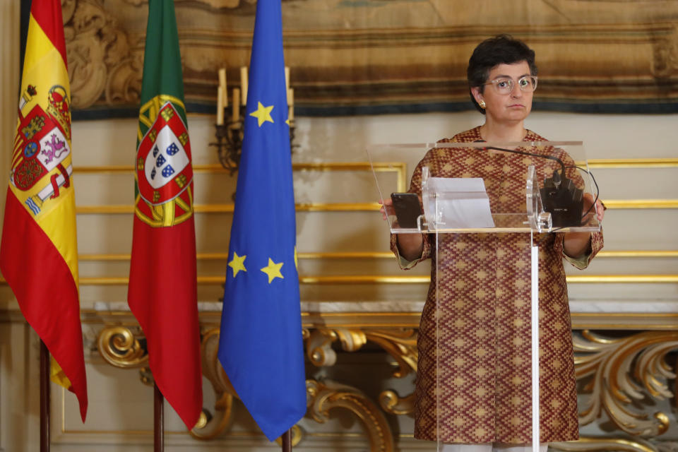 Spanish Foreign Minister Arancha Gonzalez Laya listens to a question during a joint news conference with her Portuguese counterpart Augusto Santos Silva following their meeting at the Necessidades Palace in Lisbon, Friday, Sept. 18, 2020. (AP Photo/Armando Franca)