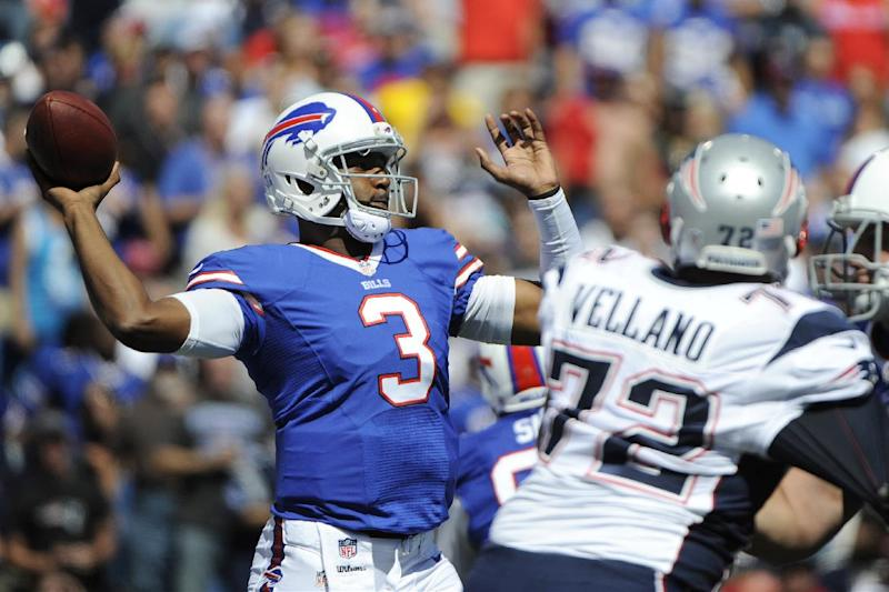 Buffalo Bills quarterback EJ Manuel (3) throws a pass during the first half of an NFL football game as New England Patriots defensive tackle Joe Vellano (72) rushes the passer on Sunday, Sept. 8, 2013, in Orchard Park. (AP Photo/Gary Wiepert)