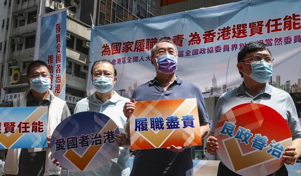 Members of the Election Committee, comprising loyalists and Hong Kong tycoons, were out in force to meet residents under a directive by Beijing last weekend. Photo: Edmond So