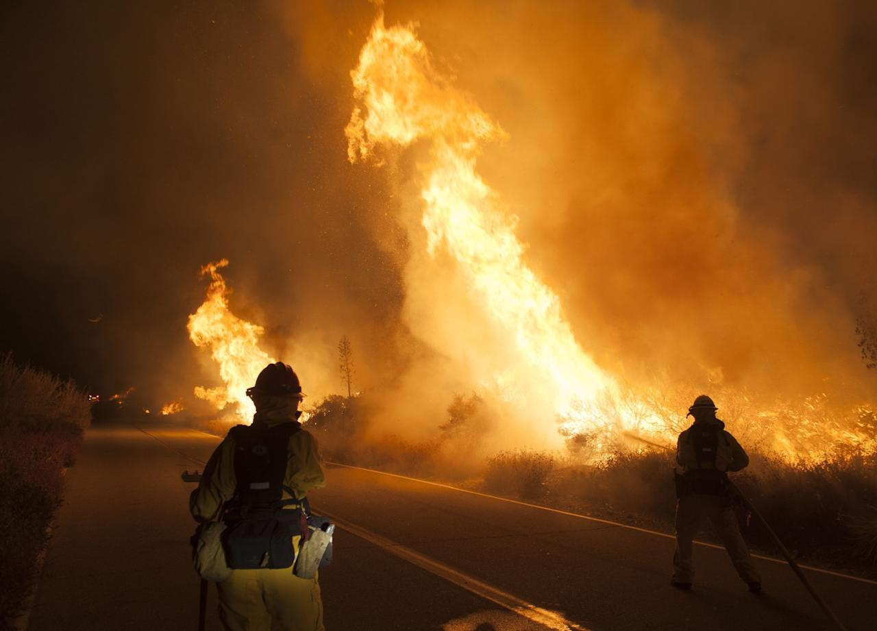 <p>Cal Fire Capt. Gretchen Gonzales, left, and firefighter Steve Rodberg, of Laguna Niguel, battle a wildfire along Lytle Creek Road, Wednesday, Aug. 17, 2016, near Keenbrook, Calif. (Kevin Sullivan/The Orange County Register via AP) </p>