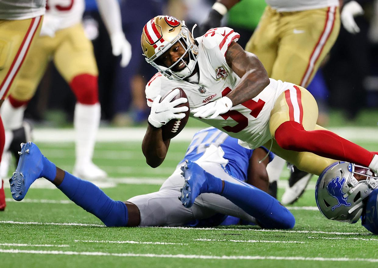 DETROIT, MICHIGAN - SEPTEMBER 12: Raheem Mostert #31 of the San Francisco 49ers is tackled during the first half against the Detroit Lions at Ford Field on September 12, 2021 in Detroit, Michigan. (Photo by Gregory Shamus/Getty Images)