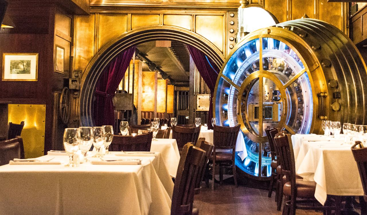 """Built inside a bank vault beneath an iconic skyscraper, Trinity Place Restaurant & Bar is stocked full of history. Enter the restaurant from one of the two vault doors weighing 35 tons and enjoy one of the bar's signature cocktails paired with a dish created by chef Donal Crosbie. <a rel=""""nofollow"""" href=""""https://www.trinityplacenyc.com/"""">trinityplacenyc.com</a>"""