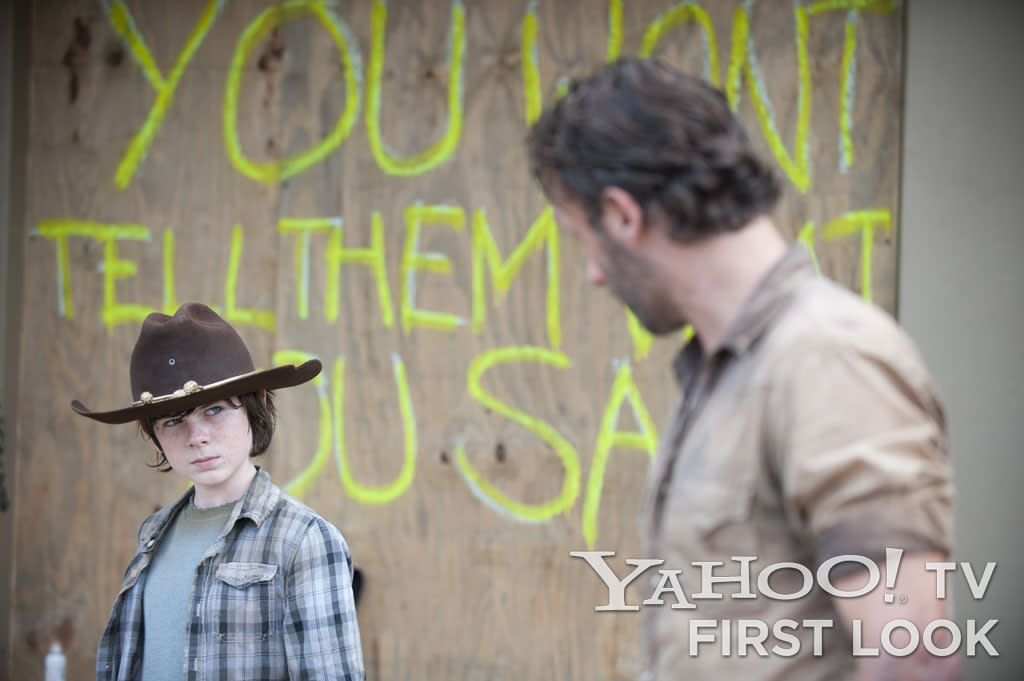 "Carl Grimes (Chandler Riggs) and Rick Grimes (Andrew Lincoln) in ""The Walking Dead"" Season 3 episode, ""Clear."""