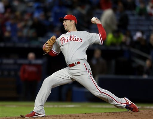 Philadelphia Phillies starting pitcher Cliff Lee throws in the first inning of a baseball game against the Atlanta Braves, Thursday, April 4, 2013, in Atlanta. (AP Photo/David Goldman)