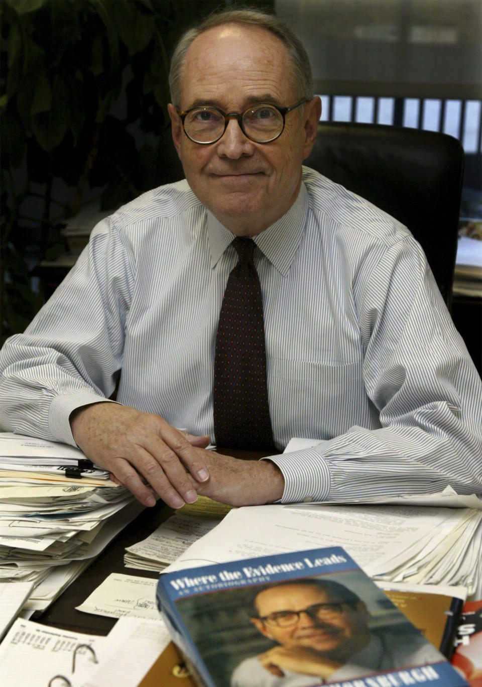 FILE - In this Sept. 30, 2003 file photo, former Pennsylvania Gov. Dick Thornburgh sits in his Washington office. Thornburgh died Thursday, Dec. 31, 2020 at a retirement community facility outside Pittsburgh, his son David said. (AP Photo/ Evan Vucci, File)