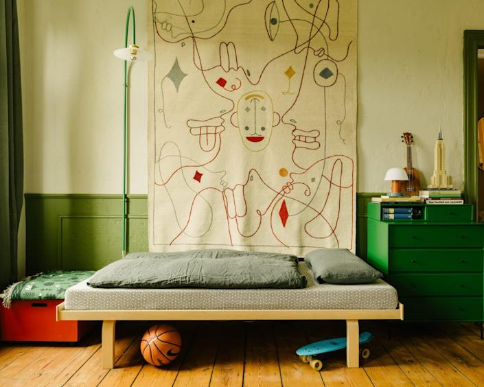 Muller Van Severen's Hanging Lamp N° 2 for Valerie Objects hangs above Justus's Alvar Aalto day bed and a Jaime Hayon rug for Nanimarquina.