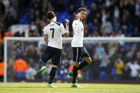 Britain Soccer Football - Tottenham Hotspur v AFC Bournemouth - Premier League - White Hart Lane - 15/4/17 Tottenham's Dele Alli celebrates after the match with Son Heung-min Action Images via Reuters / Paul Childs Livepic