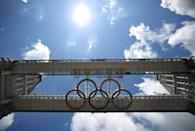 LONDON, ENGLAND - JUNE 18: Giant Olympic rings are installed under the walkways of Tower Bridge on June 18, 2012 in London, England. The rings measuring 25 metres by 11 metres will be lowered into view later this month ahead of the London 2012 Olympic games. (Photo by Peter Macdiarmid/Getty Images)