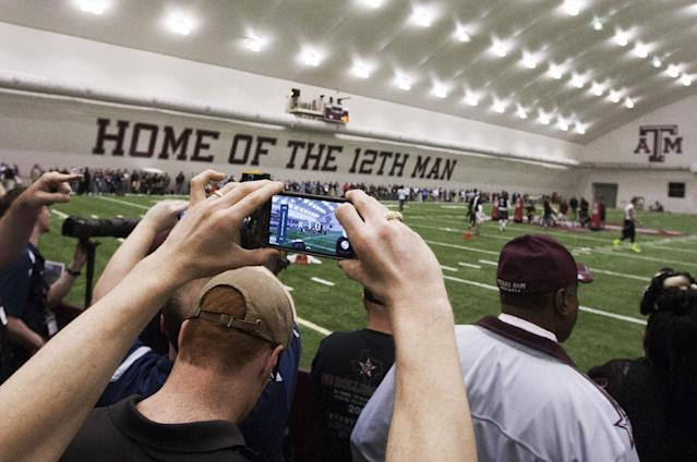 Media and NFL football representatives attend Texas A&M's pro day at the McFerrin Athletic Center in College Station, Texas, Thursday, March 27, 2014. (AP Photo/Patric Schneider)