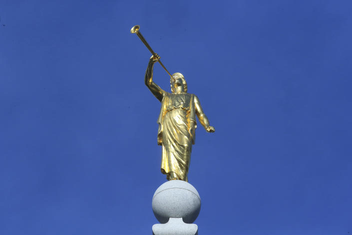 FILE - In this April 6, 2019 file photo, the angel Moroni statue sits atop the Salt Lake City temple during the The Church of Jesus Christ of Latter-day Saints' conference in Salt Lake City. For the third consecutive time, The Church of Jesus Christ of Latter-day Saints will hold its signature conference this weekend without attendees in person as the faith continues to take precautions amid the pandemic. Members of the Utah-based faith will instead watch on TVs, computers and tablets from their homes around the world Saturday, April 3, 2021 to hear spiritual guidance from the religion's top leaders, who will be delivering the speeches in Salt Lake City. (AP Photo/Rick Bowmer, File)