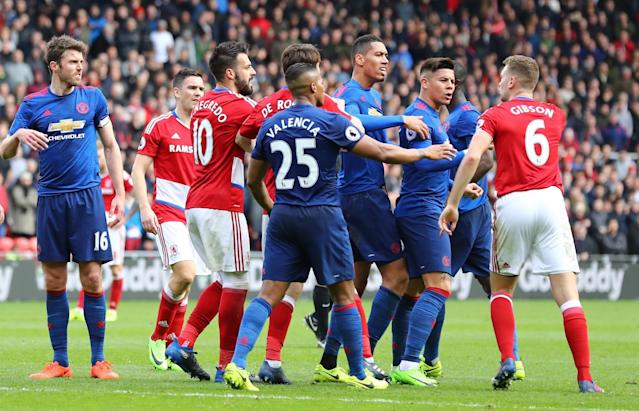 <p>United and Boro players come together after a heated exchange </p>