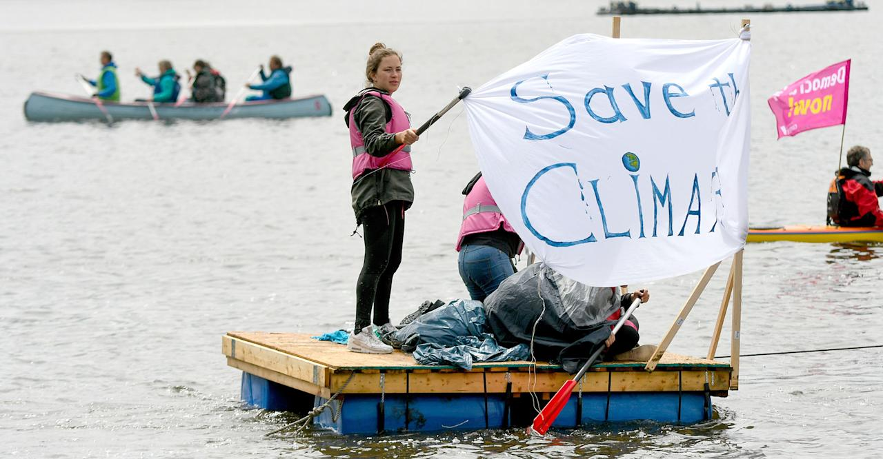 <p>Participants of the movement ' Compact' take part in a protest regatta against the G20 summit in Hamburg, Germany, Sunday, July 2, 2017. The G20 summit will take place in Hamburg on July 7 and July 8, 2017. (Axel Heimken/dpa via AP) </p>