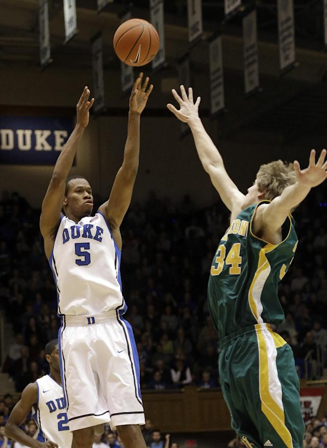 Duke's Rodney Hood (5) shoots as Vermont's Kurt Steidl (34) defends during the first half of an NCAA college basketball game in Durham, N.C., Sunday, Nov. 24, 2013. (AP Photo/Gerry Broome)