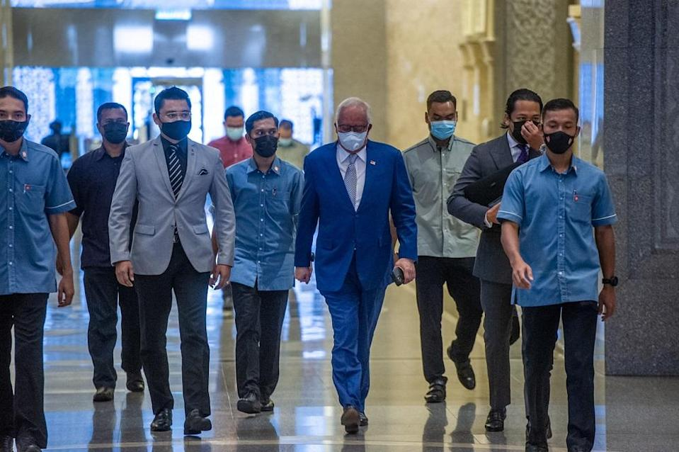 Former Prime Minister, Datuk Seri Najib Razak arrives at the Court of Appeal in Putrajaya April 15, 2021. — Picture by Shafwan Zaidon
