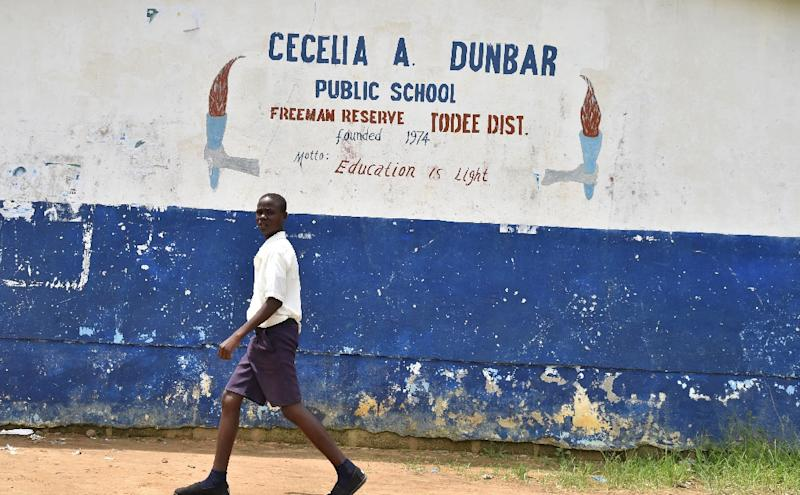 Under the controverisal scheme private education companies take over the day-to-day running of schools like the Cecelia Dunbar school, about 30 kilometres from Monrovia (AFP Photo/ISSOUF SANOGO)