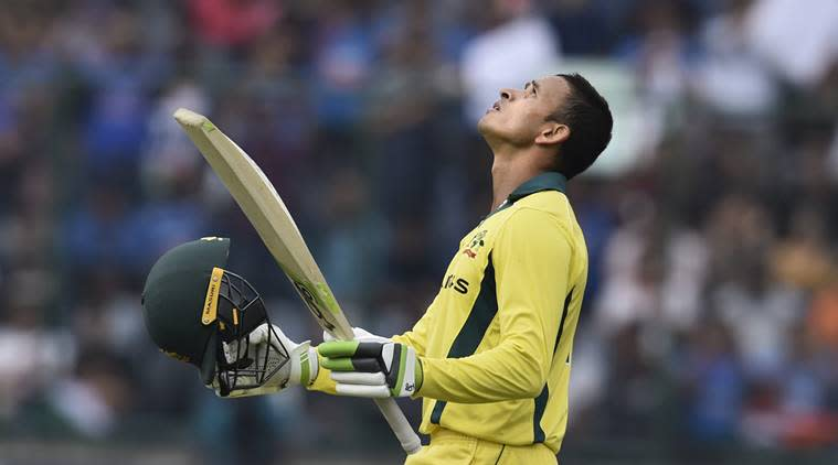 Australian batsman Usman Khawaja raises his bat after scoring his century during the 5th ODI cricket match against India, at Feroz Shah Kotla Cricket Stadium in New Delhi