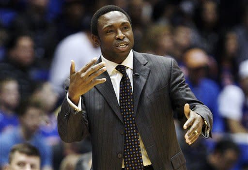Brooklyn Nets head coach Avery Johnson calls out to his team during the first half of an NBA preseason basketball game against the New York Knicks, Wednesday, Oct. 24, 2012, in Uniondale, N.Y. (AP Photo/Frank Franklin II)