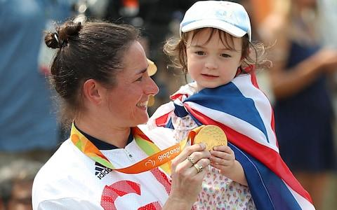 Great Britain's Sarah Storey celebrates with her daughter Louisa after winning gold in the Women's Time Trial C5 held in Pontal during the seventh day of the 2016 Rio Paralympic Games - Credit: PA