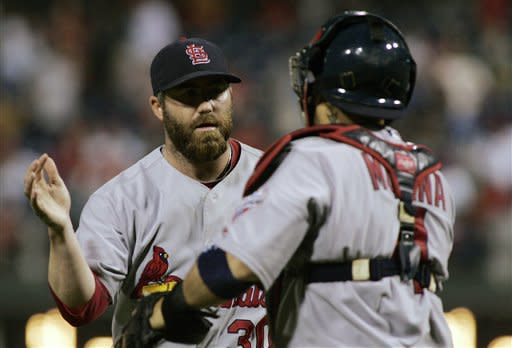 St. Louis Cardinals closer Jason Motte, left, and catcher Yadler Molina celebrate their win over the Philadelphia Phillies in a baseball game on Saturday, Aug. 11, 2012, in Philadelphia. The Cardinals won 4-1. (AP Photo/Tom Mihalek)