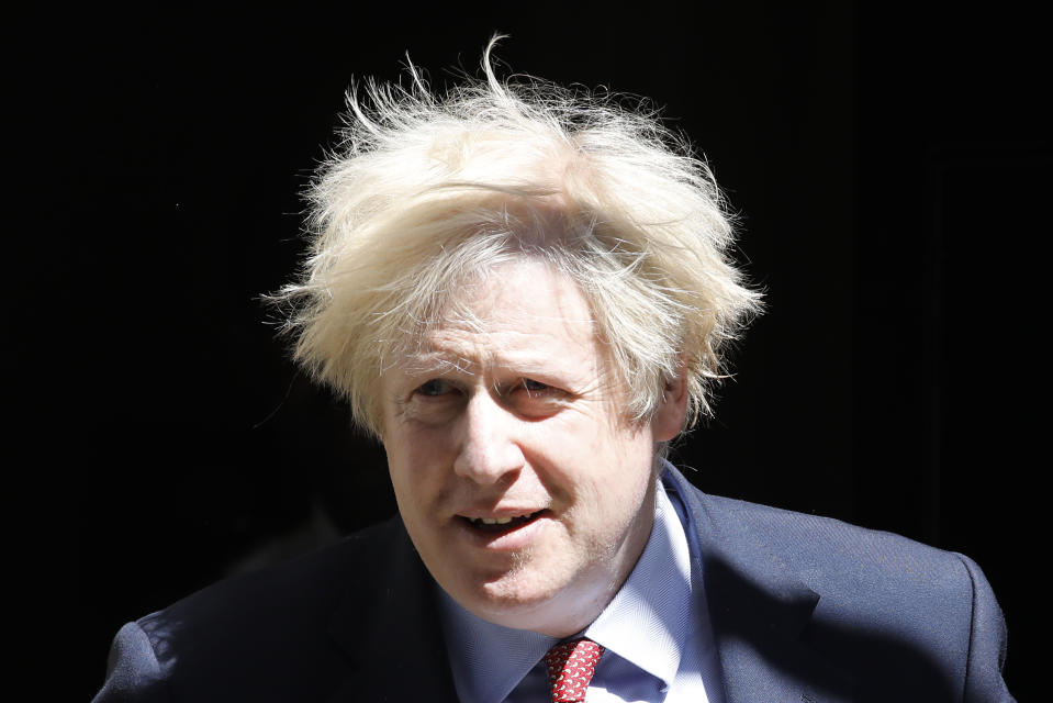 Britain's Prime Minister Boris Johnson leaves 10 Downing Street in central London on May 20, 2020 to attend Prime Minister's Questions (PMQs) in the Houses of Parliament. -  (Photo by Tolga AKMEN / AFP) (Photo by TOLGA AKMEN/AFP via Getty Images)
