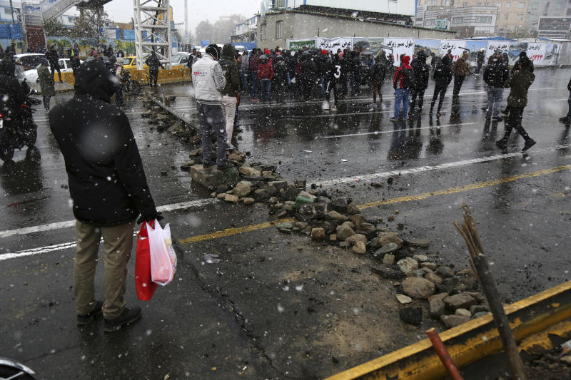 A road is blocked by protestors after authorities raised gasoline prices, in Tehran, Iran, Saturday, Nov. 16, 2019. Protesters angered by Iran raising government-set gasoline prices by 50% blocked traffic in major cities and occasionally clashed with police Saturday after a night of demonstrations punctuated by gunfire. (Majid Khahi/ISNA via AP)