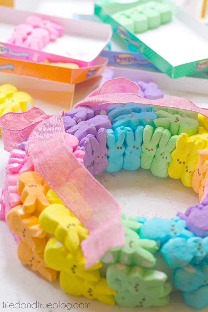 """<p>Raise your hand if you love marshmallow Peeps! Although they're great for snacking, they're also surprisingly perfect for making an Easter wreath.</p><p><strong>Get the tutorial at <a href=""""https://www.triedandtrueblog.com/rainbow-bunny-peeps-wreath/"""" rel=""""nofollow noopener"""" target=""""_blank"""" data-ylk=""""slk:Tried & True Creative"""" class=""""link rapid-noclick-resp"""">Tried & True Creative</a>.</strong></p><p><a class=""""link rapid-noclick-resp"""" href=""""https://go.redirectingat.com?id=74968X1596630&url=https%3A%2F%2Fwww.walmart.com%2Fip%2F600-Count-Round-2-5-Long-Wooden-Toothpicks-Great-for-Appetizers-Baking-and-more%2F574228021&sref=https%3A%2F%2Fwww.thepioneerwoman.com%2Fhome-lifestyle%2Fcrafts-diy%2Fg35698457%2Fdiy-easter-wreath-ideas%2F"""" rel=""""nofollow noopener"""" target=""""_blank"""" data-ylk=""""slk:SHOP TOOTHPICKS"""">SHOP TOOTHPICKS</a></p>"""