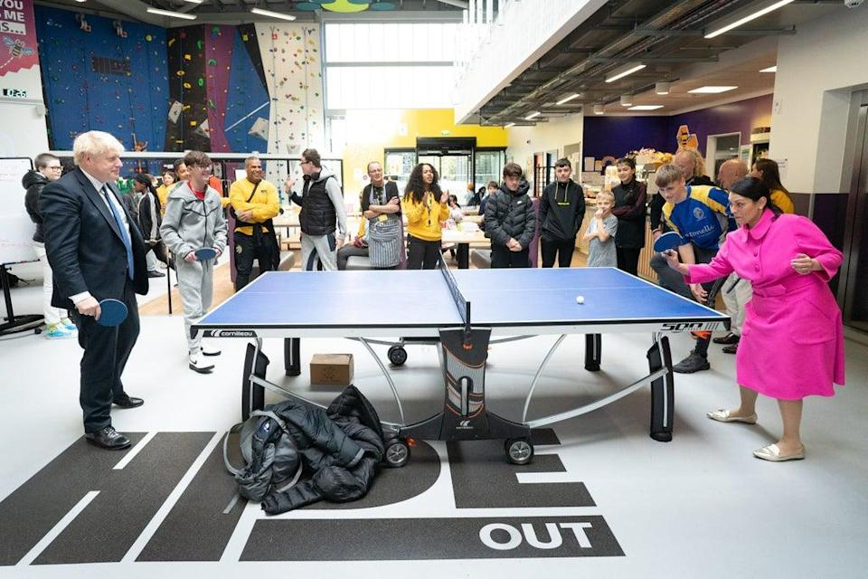 Prime Minister Boris Johnson plays table tennis with Home Secretary Priti Patel during their visit (Stefan Rousseau/PA) (PA Wire)