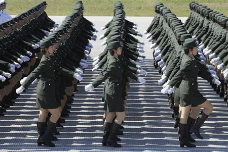 Female soldiers from the Chinese People's Liberation Army Ground Force march in formation during a training session at the 60th National Day Parade Village in the outskirts of Beijing