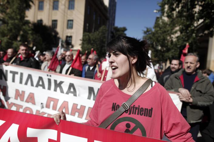 A member of pro-communist union PAME shouts slogans during a protest in Athens, Wednesday, Feb. 20, 2013. Thousands of anti-austerity demonstrators took to the streets of Athens on Wednesday as unions staged a general strike to protest the government's spending cuts and tax hikes, which some predict will push unemployment to a stunning 30 percent this year. (AP Photo/Petros Giannakouris)