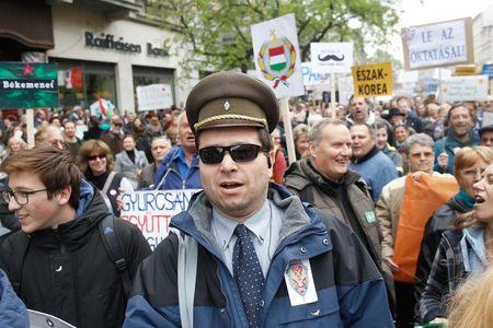 Hungarians protest against the rightwing government at a rally organised by spoof Two-tailed Dog Party in Budapest