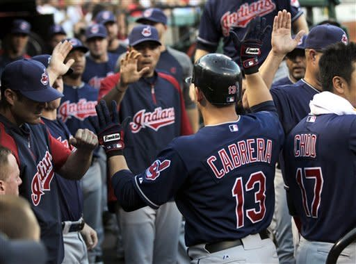 Tomlin, Damon lead Indians over Cardinals 6-2