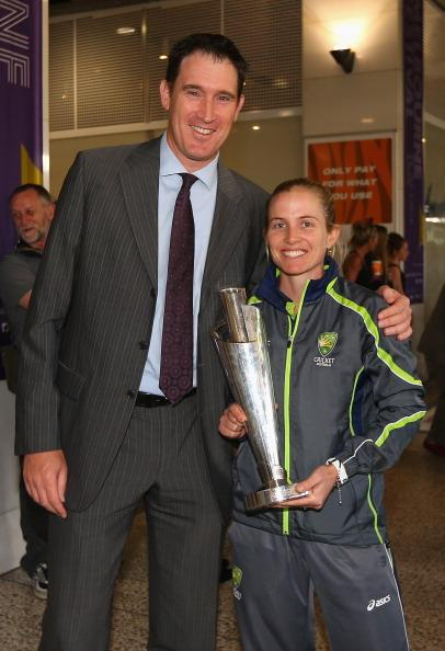 MELBOURNE, AUSTRALIA - OCTOBER 09:  Jodie Fields of the Southern Stars poses with James Sutherland the CEO of Cricket Australia after arriving back home to Australia after winning the 2012 ICC Women's T20 World Cup, at Melbourne International Airport on October 9, 2012 in Melbourne, Australia.  (Photo by Quinn Rooney/Getty Images)