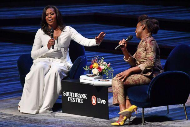PHOTO: Former first lady Michelle Obama speaks with Nigerian novelist Chimamanda Ngozi Adichie at the Royal Festival Hall in London on Dec. 3, 2018. (Ben Stansall/AFP/Getty Images)