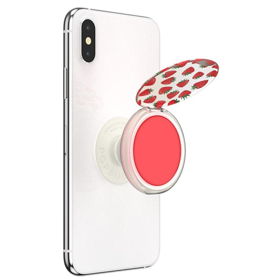"""<p>popsockets.com</p><p><strong>$15.00</strong></p><p><a href=""""https://go.redirectingat.com?id=74968X1596630&url=https%3A%2F%2Fwww.popsockets.com%2Fp%2Fpopgrip-lips-strawberry-feels%2F701084.html%3Flang%3Den_US&sref=http%3A%2F%2Fwww.goodhousekeeping.com%2Fholidays%2Fgift-ideas%2Fg153%2Fgifts-under-20-dollars%2F"""" rel=""""nofollow noopener"""" target=""""_blank"""" data-ylk=""""slk:Shop Now"""" class=""""link rapid-noclick-resp"""">Shop Now</a></p><p>Not only does this Popsocket help keep her phone glued to her hands (a necessity for selfie-taking, really), but it can be filled with a swappable lip balm perfect for on-the-go touch-ups. </p>"""