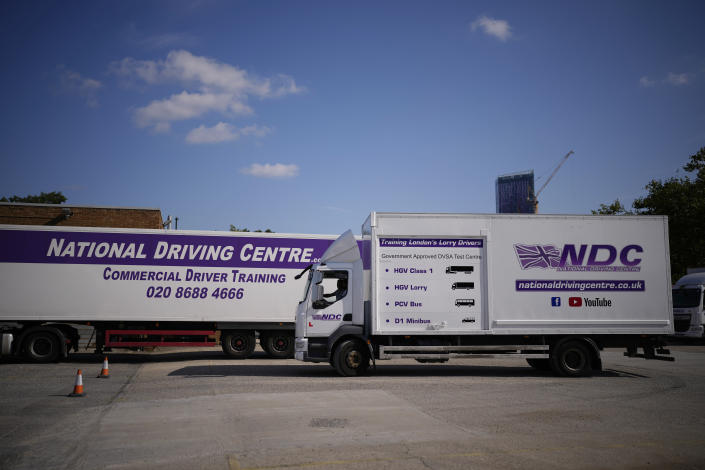 An instructor drives whilst training a learner truck driver sat next to him in the truck cab, at the National Driving Centre in Croydon, south London, Wednesday, Sept. 22, 2021. Britain doesn't have enough truck drivers. The shortage is contributing to scarcity of everything from McDonald's milkshakes to supermarket produce. (AP Photo/Matt Dunham)