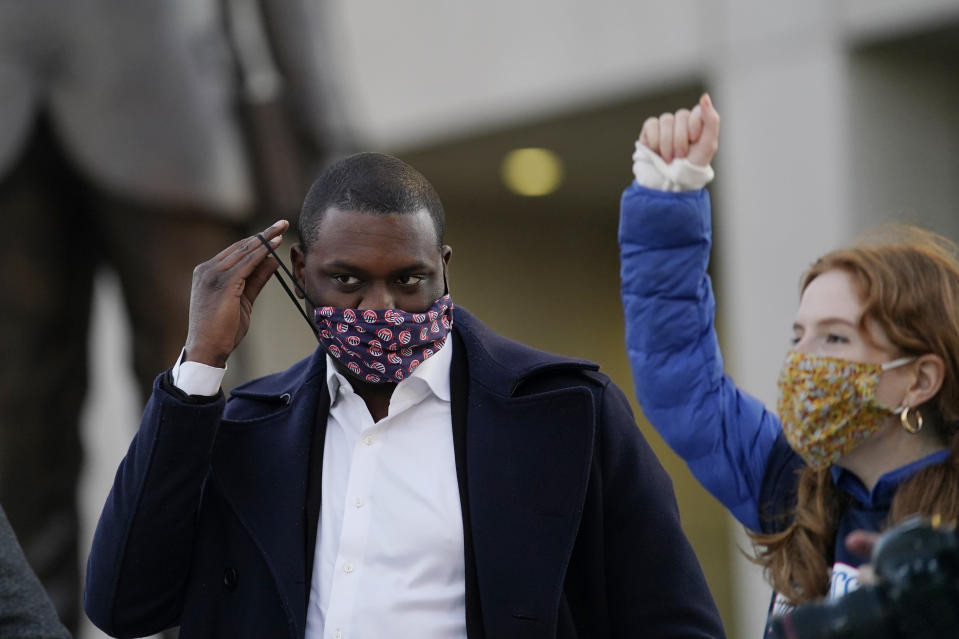 A supporter cheers as Mondaire Jones, left, replaces his face mask after speaking at a Protect the Results rally, Wednesday, Nov. 4, 2020, in front of the Westchester County Courthouse in White Plains, N.Y. Jones and Ritchie Torres, both Democrats, became the first gay Black men elected to the U.S. House. (AP Photo/Kathy Willens)
