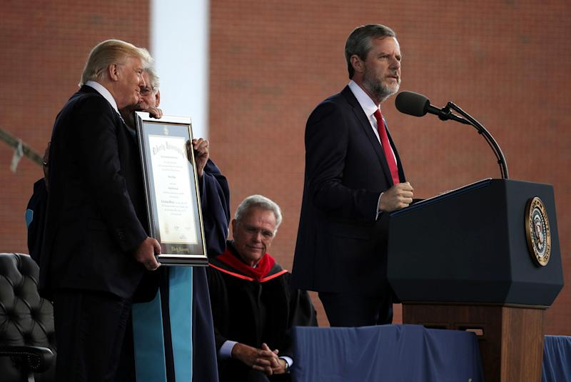 Jerry Falwell Jr. speaks as President Trump is presented with a Doctorate of Laws  during a commencement at Liberty University on May 13, 2017, in Lynchburg, Virginia. (Alex Wong via Getty Images)