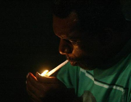 MAN LIGHTS JOINT AT JAMAICAN LABOUR PARTY RALLY.