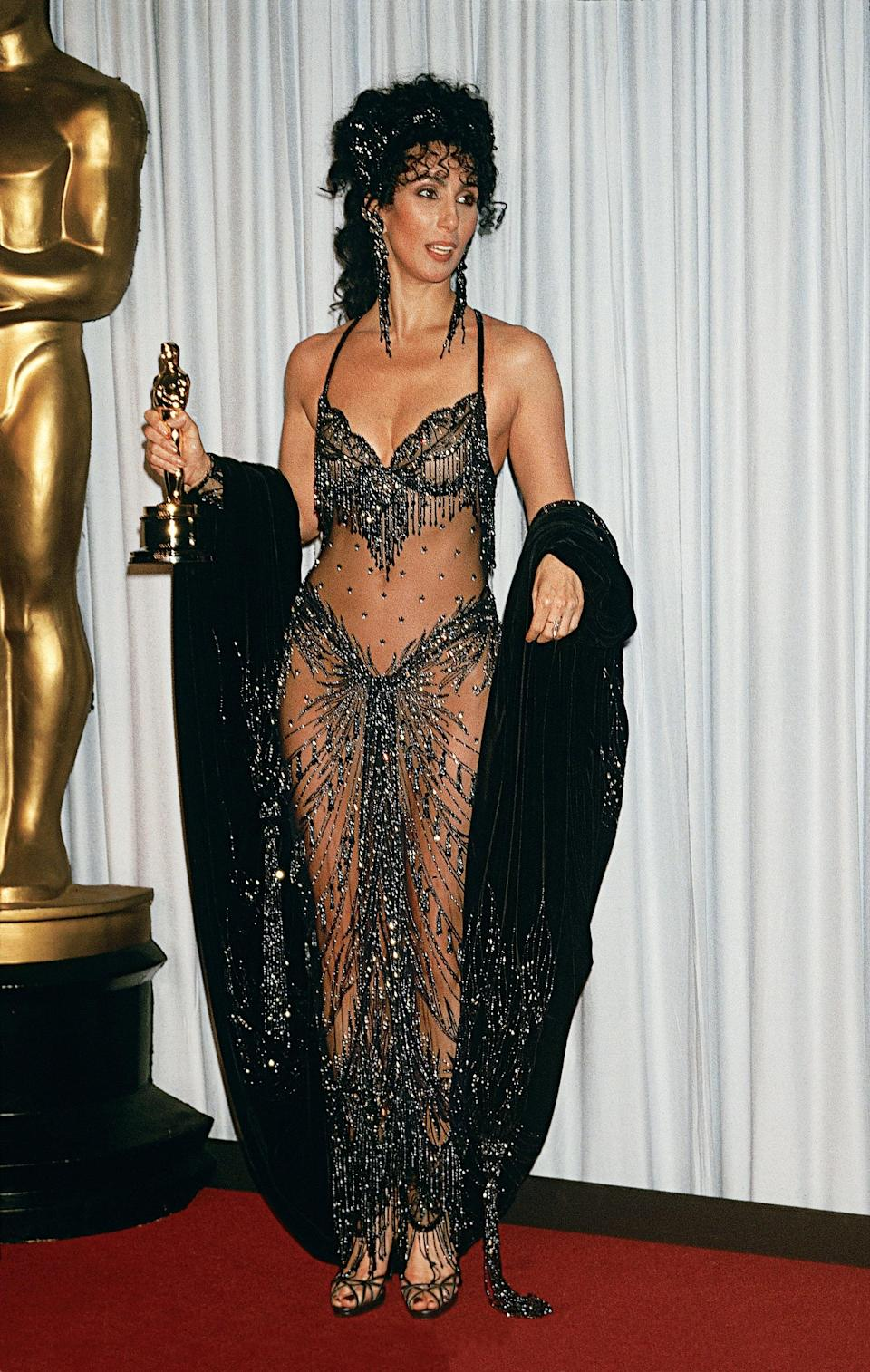 <p>Cher looked as stunning as ever while holding her award for best actress for the movie <strong>Moonstruck</strong>.</p>