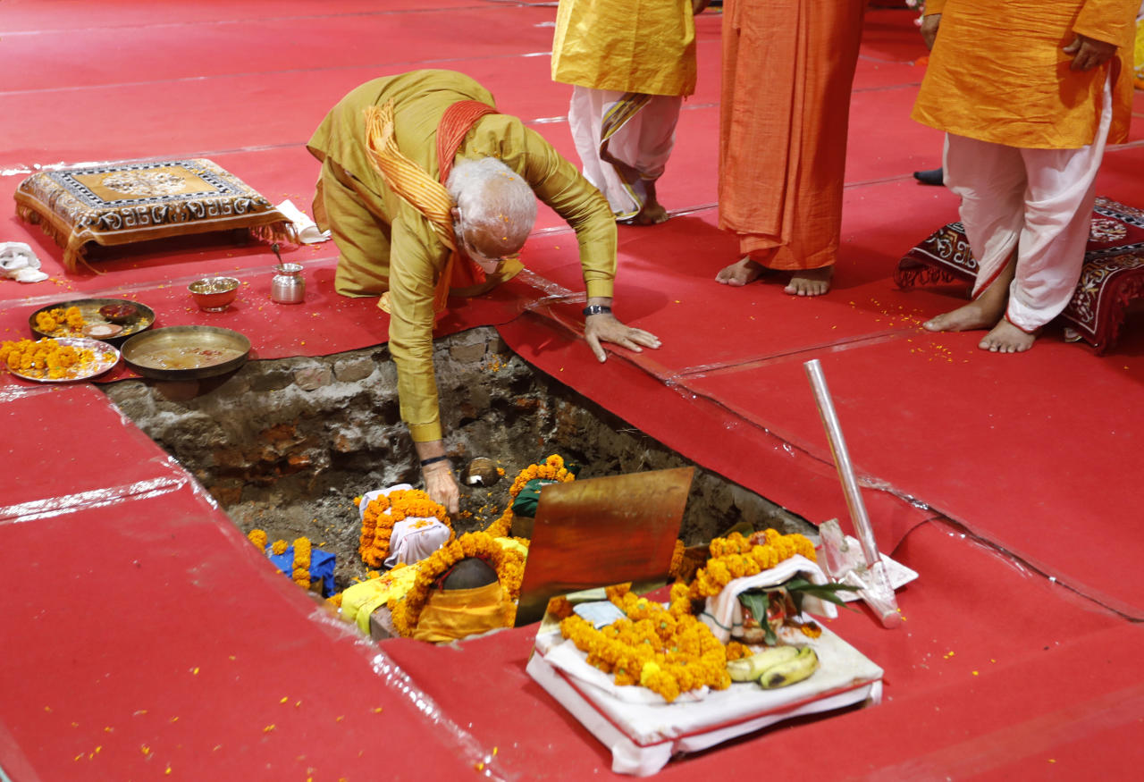 Indian Prime Minister Narendra Modi performs rituals during the groundbreaking ceremony of a temple dedicated to the Hindu god Ram, in Ayodhya, India, Wednesday, Aug. 5, 2020. Hindus rejoiced as Modi broke ground on a long-awaited temple of their most revered god, Ram, at the site of a demolished 16th century mosque. (AP Photo/Rajesh Kumar Singh)