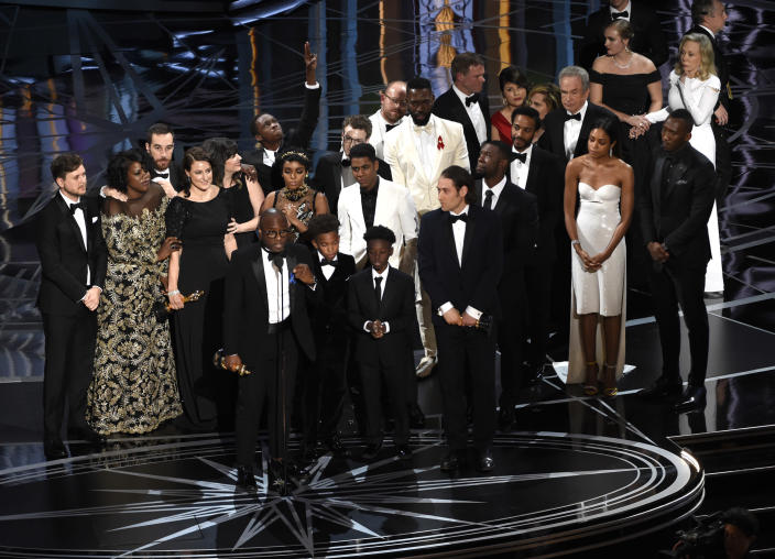 """FILE - This Feb. 26, 2017 file photo shows Barry Jenkins and the cast and crew of """"Moonlight"""" accepting the award for best picture at the Oscars in Los Angeles. (Photo by Chris Pizzello/Invision/AP, File)"""