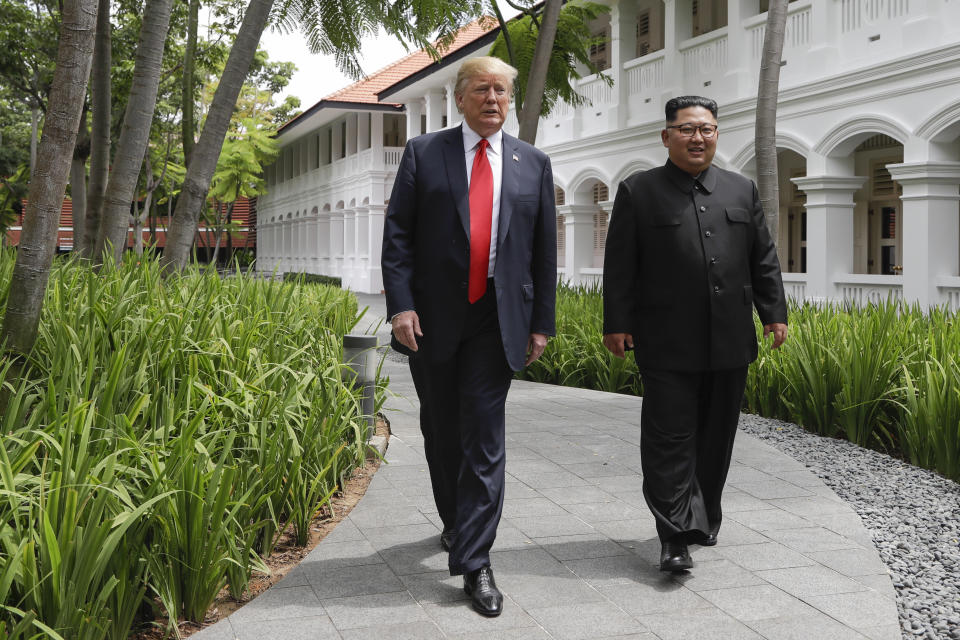 U.S. President Donald Trump and North Korea leader Kim Jong Un walk from their lunch at the Capella resort on Sentosa Island Tuesday, June 12, 2018 in Singapore. (AP Photo/Evan Vucci)
