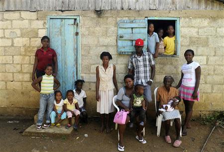 Sentilia Igsema, born in 1930 in the Dominican Republic to Haitian immigrants, poses with four generations of her family in Batey La Higuera